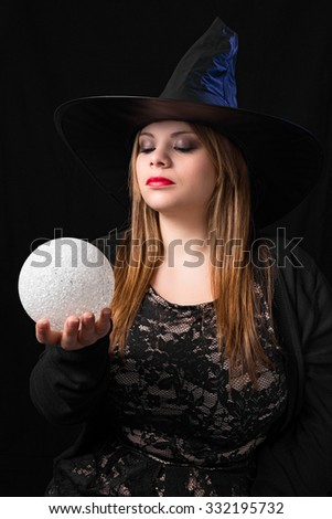 sensual witch with magic ball  - stock photo