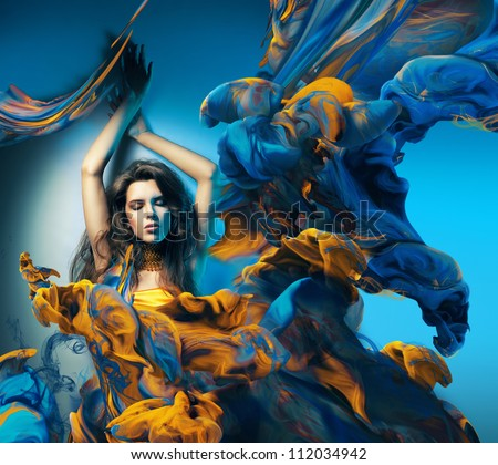 sensual woman and big paint waves - stock photo