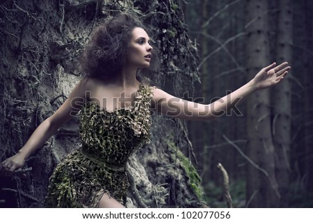 Sensual woman as a part of tree - stock photo