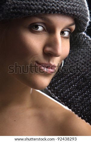 sensual woman in knitted hat posing in studio - stock photo