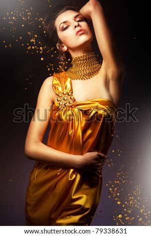 sensual woman in long yellow dress - stock photo