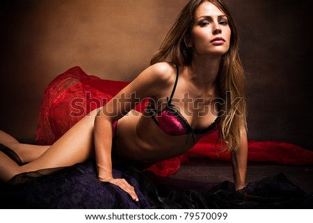 sensual woman in underwear studio shot dark background