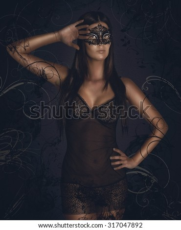 Sensual woman in underwear with black mask - stock photo