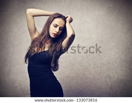 sensual woman on gray background - stock photo