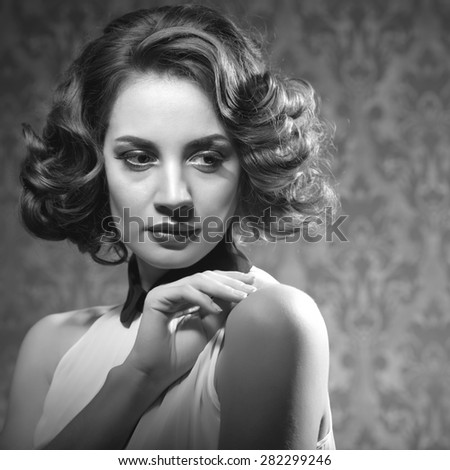 Sensual woman vintage interior retro style. Professional make up and studio shooting - stock photo