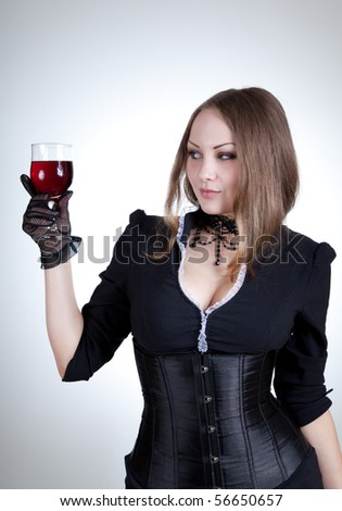 Sensual woman with glass of wine, studio shot - stock photo