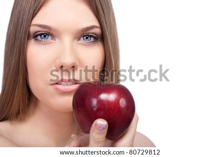 sensual woman with red apple, looking at camera on  white background