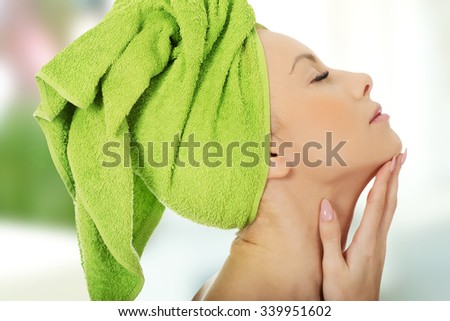 Sensual woman with towel wrapped on head. - stock photo