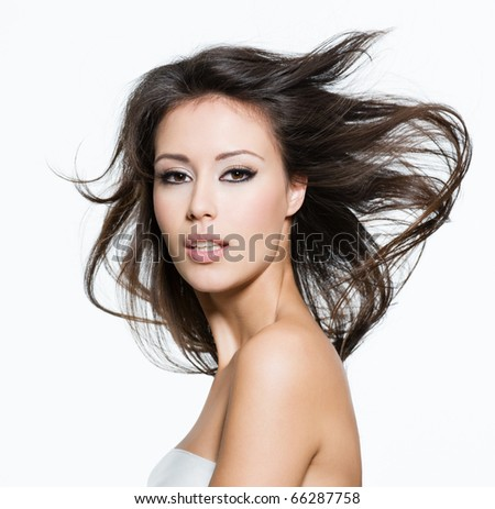 Sensual young adult woman with beautiful long brown hairs, posing isolated on white - stock photo