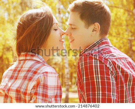 Sensual young couple kissing in autumn day - stock photo