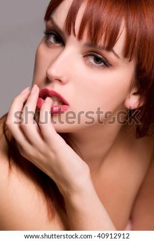 Sensual young redhead woman portrait - stock photo