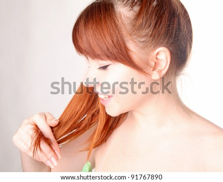 Sensual young smiling woman with beautiful long red hair - stock photo