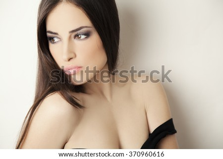sensual young woman portrait with brown eyes and hair, studio white