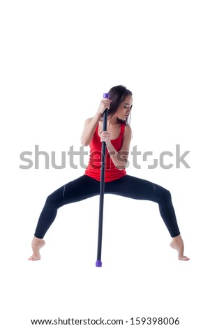 Sensual young woman posing with fitness bar - stock photo