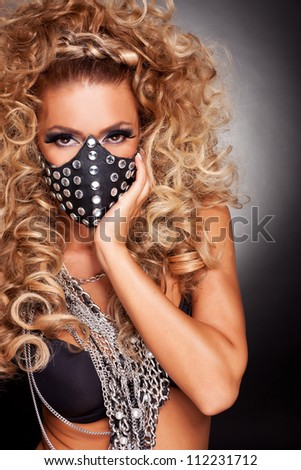 sensual young woman sado masochist with her face against her palm - stock photo