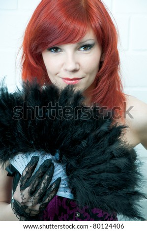 Sensual young woman with a fan, toned image - stock photo