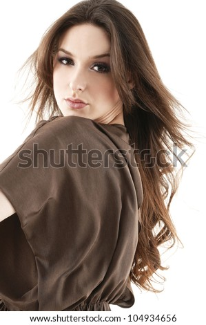 Sensual young woman with beautiful long brown hairs, posing - stock photo