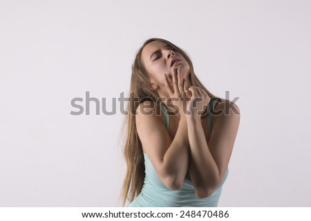 sensual young woman with closed eyes
