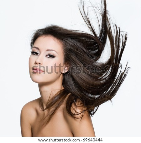 Sensual young woman with creative hairstyle, posing isolated on white - stock photo