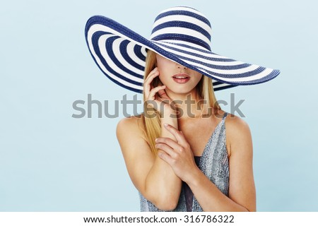 Sensuous woman in swimsuit and fashionable hat - stock photo