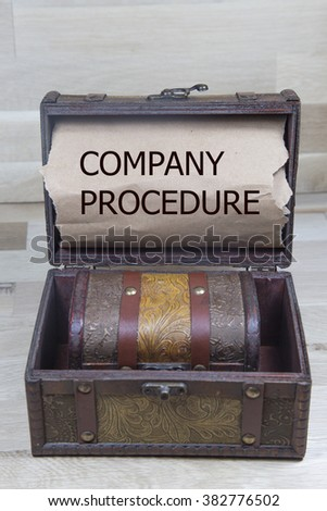 sentence company procedure written with torn paper on a , on a wooden treasure chest