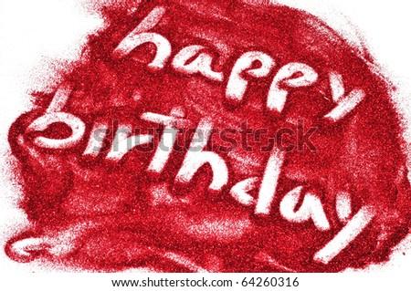 sentence happy birthday written on red glitter - stock photo