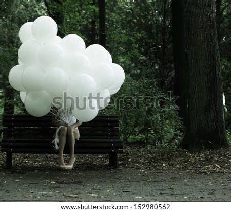 Sentimentality. Nostalgia. Lonely Woman with Air Balloons sitting on Bench in the Park - stock photo
