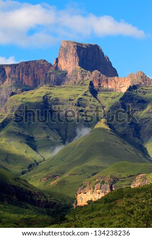Sentinal peak in the amphitheater of the Drakensberg mountains, Royal Natal National Park, South Africa - stock photo