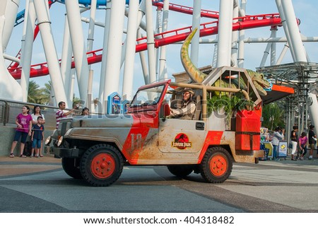 "Sentosa Universal Studios, Singapore - 1 March, 2014 : Jurassic Park's jeep with dinosaur in the ""Hollywood Dreams Parade"""