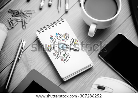 seo doodle against notepad on desk - stock photo