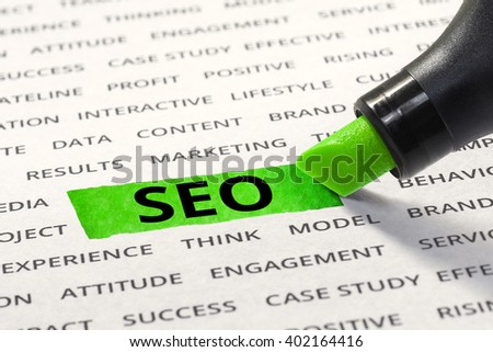 SEO message highlighted with marker on paper of other related words. For direction of business strategy success concept - stock photo