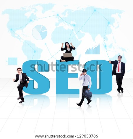 SEO (Search Engine Optimization) with business people surround it - stock photo