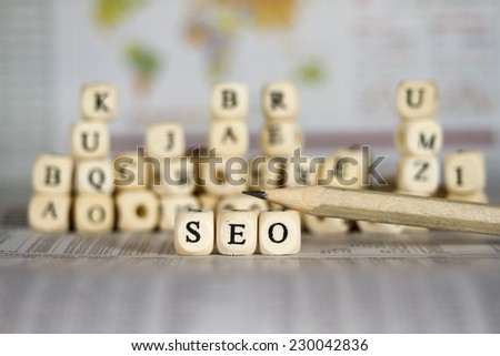 SEO search engine optimization word on newspaper background - stock photo