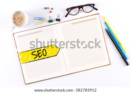 SEO text on notebook with copy space - stock photo