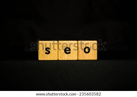 SEO  wood Cubic on black background - stock photo