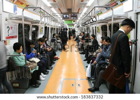 SEOUL - APRIL 26 : Inside view of Metropolitan Subway in Seoul, one of the most heavily used underground system in the world, service 8 million passengers daily, on April 26, 2011, Seoul, South Korea. - stock photo