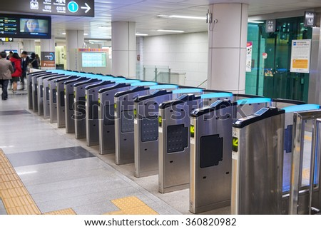 Seoul, Korea - December 9, 2015: ticket gate at City Hall subway station. The ticket barrier is a general gate type in most of subway in the city.