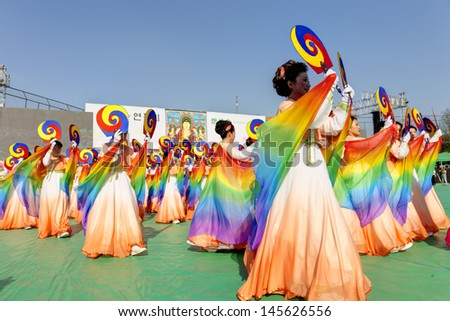 SEOUL KOREA MAY 11: Actresses are performing at Buddhist Cheer Rally for celebration of Lotus Lantern Festival on may 11 2013 at Dongguk University Stadium, Seoul, Korea. in Seoul Korea.  - stock photo