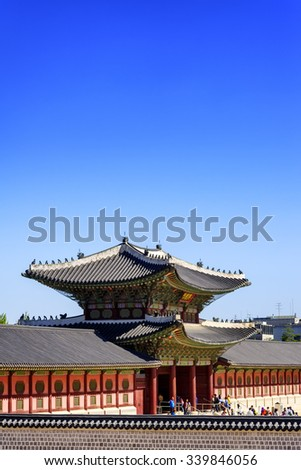 SEOUL, KOREA - OCTOBER 9, 2015 : Gyeongbokgung Palace, place of historical importance and most popular tourist attraction where tourists come to visit the elegant architectural magnificent.  - stock photo