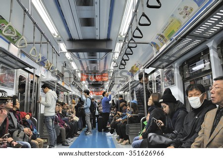 SEOUL - NOVEMBER 10 : Inside view of Metropolitan Subway Seoul, one of the most heavily used underground system in the world, service 8 million passengers daily November 10, 2015, Seoul, South Korea. - stock photo