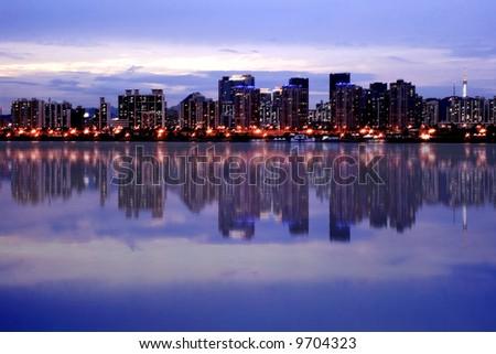 Seoul Skyline Majestic reflection at Han River - stock photo