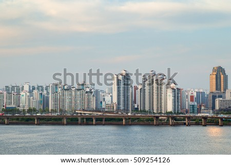 SEOUL, SOUTH KOREA - APRIL 29, 2016: Residential district along the Han River viewed from the Mapo Bridge in Seoul, South Korea. Copy space.