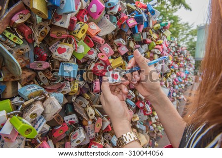 Seoul, South Korea - August 23, 2015: Thousands of love padlocks at N Seoul Tower. Locks of love is a custom in some cultures which symbolize their love will be locked forever, Seoul South Korea