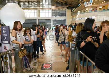 SEOUL, SOUTH KOREA - CIRCA MAY, 2017: people with cameras at Gimpo Airport International Terminal. Gimpo International Airport is located in the far western end of Seoul.