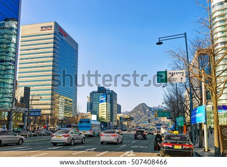 Seoul, South Korea - March 11, 2016: Busy roads with much car traffic and Modern skyscrapers in Jung district of Seoul, South Korea. People on the background