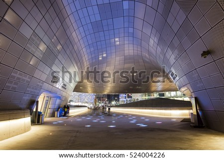 SEOUL, SOUTH KOREA - NOVEMBER 20: Dongdaemun Design Plaza at Night, New development in Seoul, designed by Zaha Hadid. Photo taken  November 20, 2016 in Seoul, South Korea.