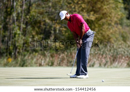 Sep 15, 2013; Lake Forest, IL, USA; Tiger Woods putts the sixth green during the third round of the BMW Championship at Conway Farms Golf Club. - stock photo
