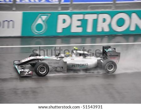 SEPANG F1 CIRCUIT, MALAYSIA - APR 3 : Nico Rosberg of Team Mercedes GP  speeding on wet track during qualifying session on April 3, 2010 in Sepang F1 Circuit, Malaysia - stock photo