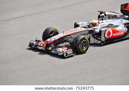 SEPANG F1 CIRCUIT,MALAYSIA - APRIL 8: Lewis Hamilton of Vodafone McLaren Mercedes in action at PETRONAS Malaysia Grand Prix during qualifying session on April 8, 2011 in Sepang, Malaysia - stock photo