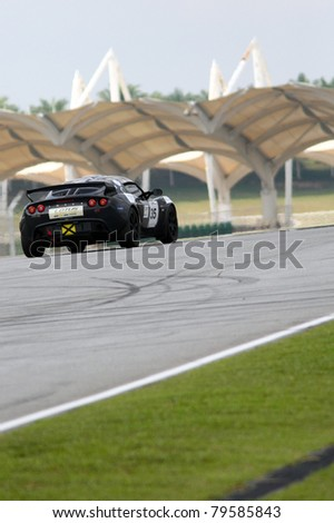 SEPANG - JUNE 17: Ravindra Panchalingam in a Lotus Exige S takes to the tracks of the Sepang International Circuit at the GT Asia Series race on June 17, 2011 in Sepang, Malaysia. - stock photo